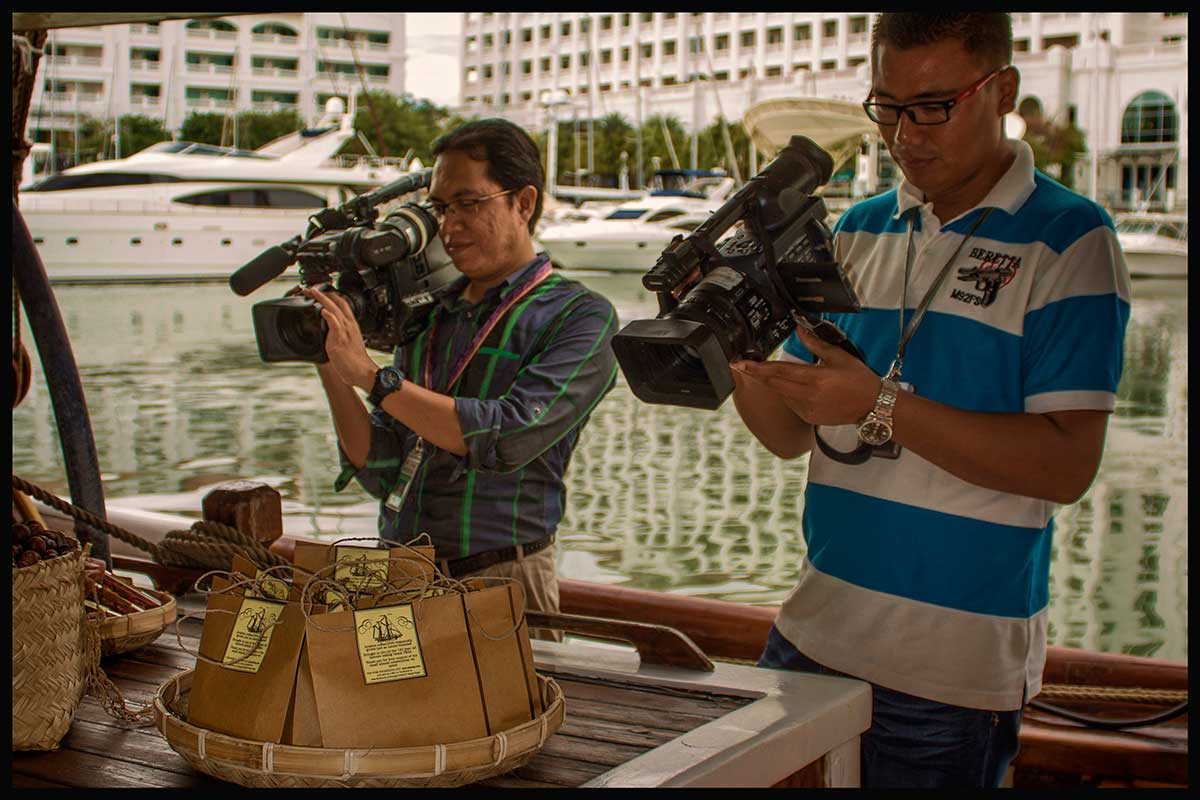 The press had a great time on board opening day. The small bags contain wild mountain coffee from East Timor.