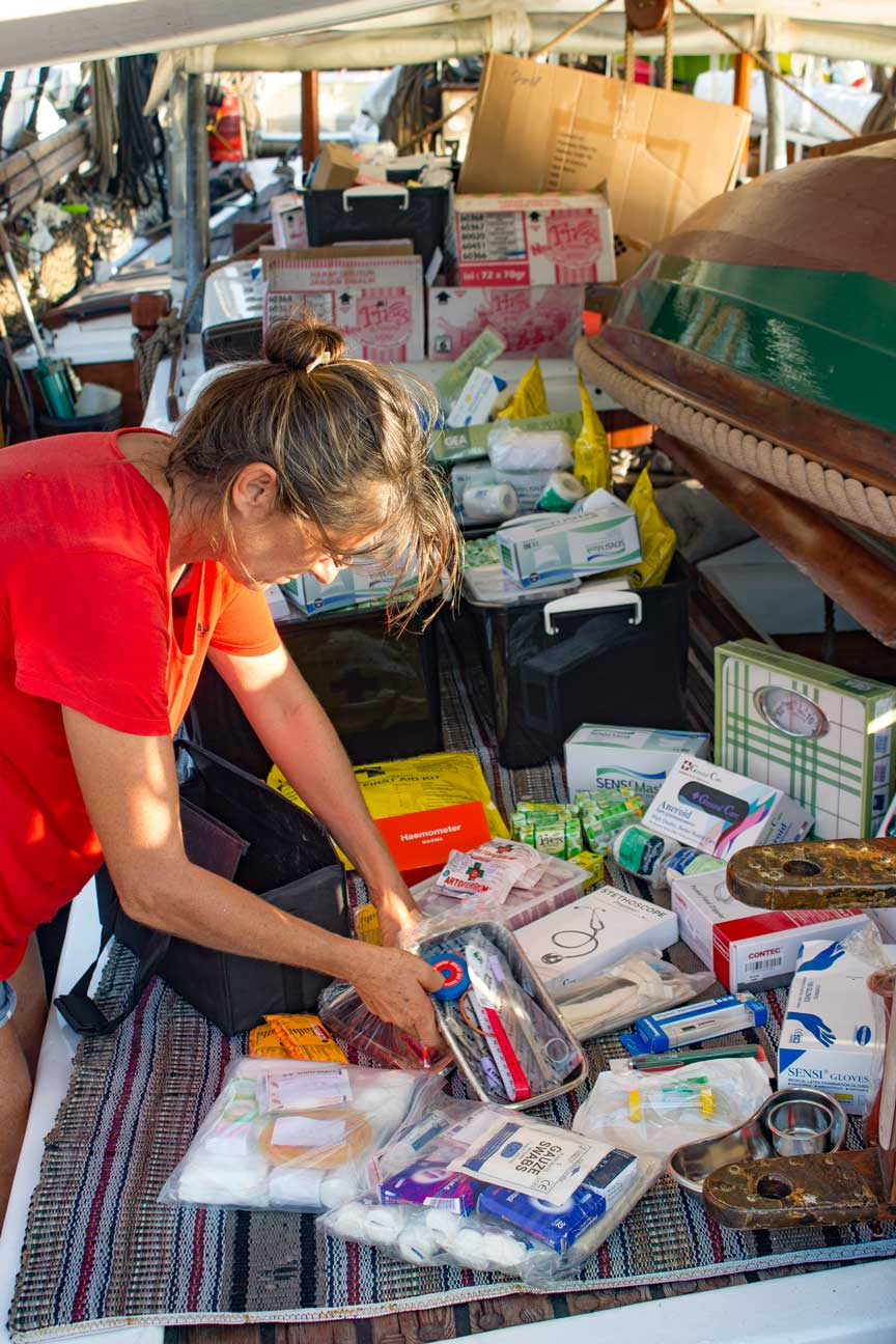 Meggi sorting midwife kits for this years deliveries.